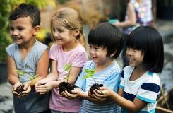 Children holding plants